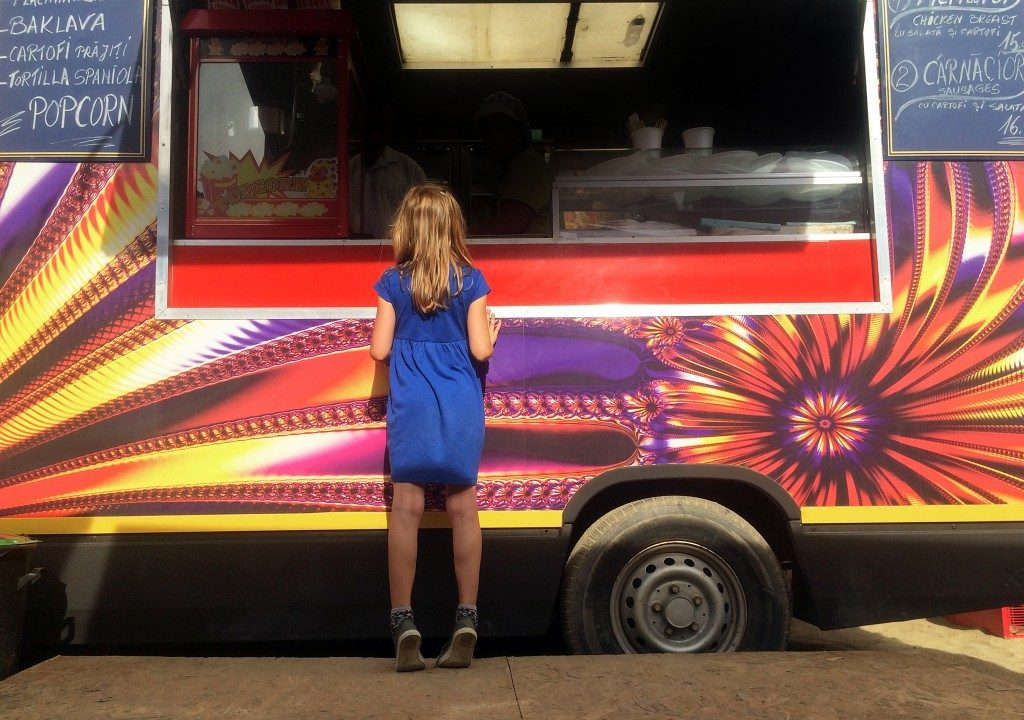 Girl buying from a food truck