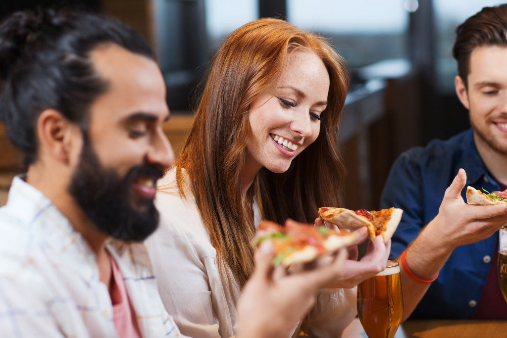 people enjoying pizza