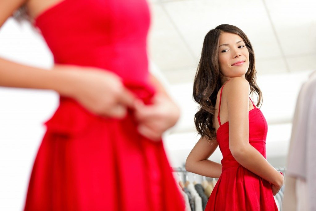 woman fitting a red dress