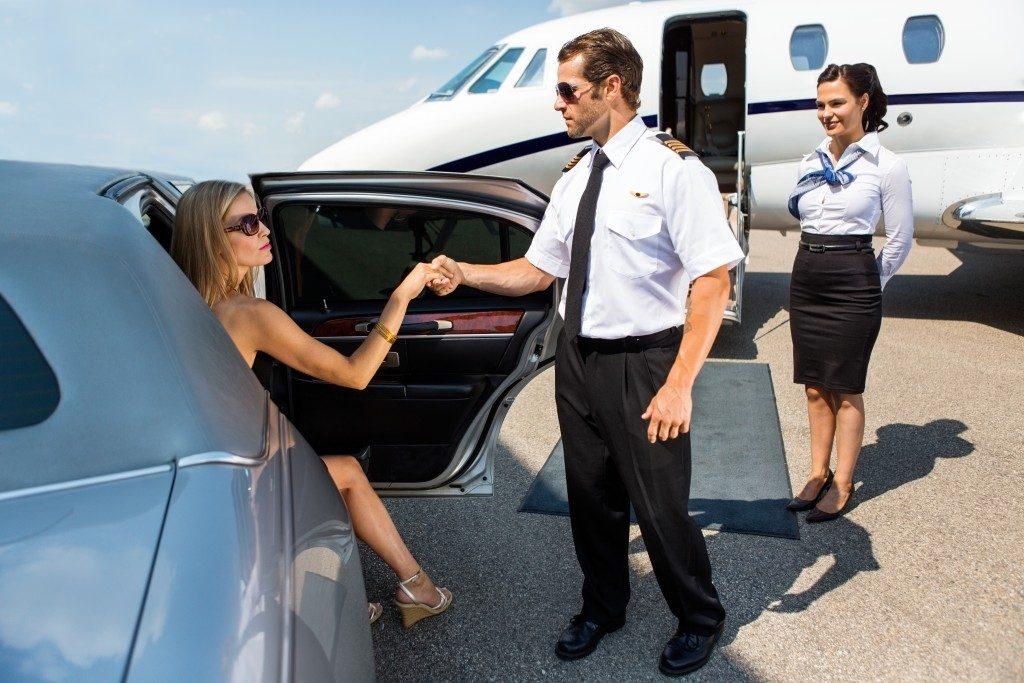 pilot helping VIP woman