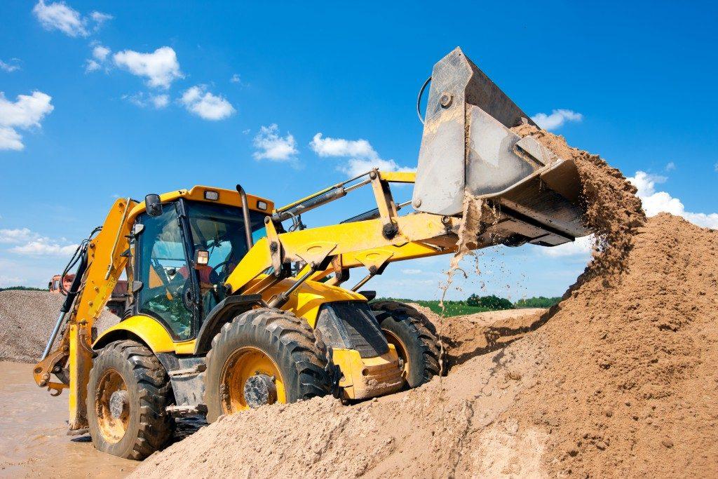 earth mover transferring soil