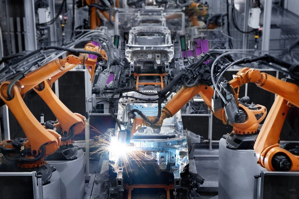 Car manufacturing with robotic hands