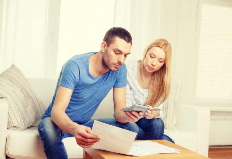 Couple computing their bills