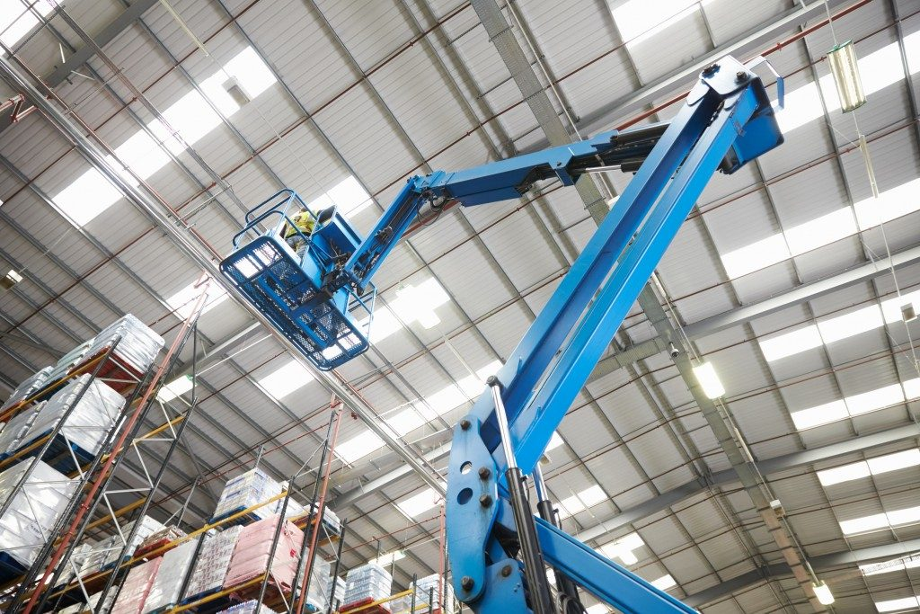 Moving stock in a warehouse with a cherry picker