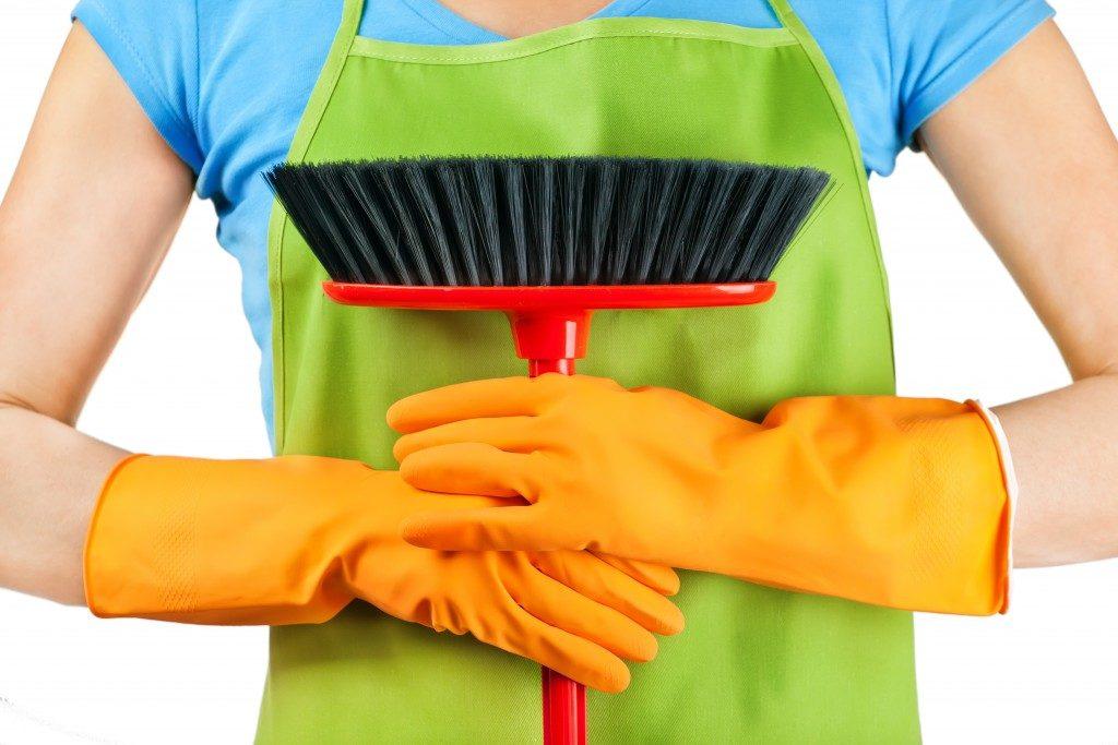 holding a mop