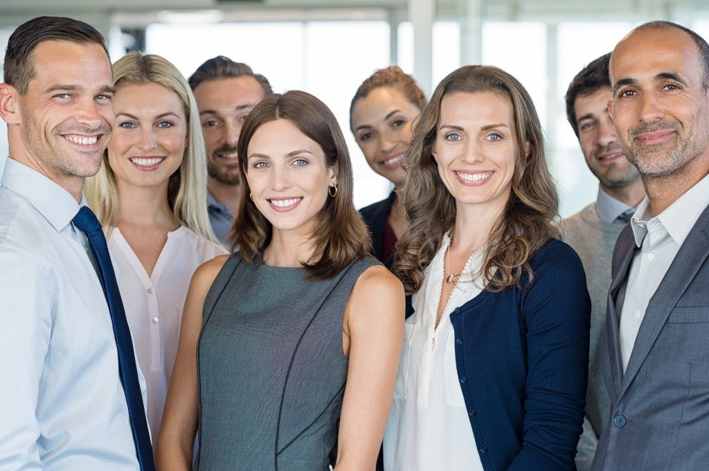 group of employees smiling