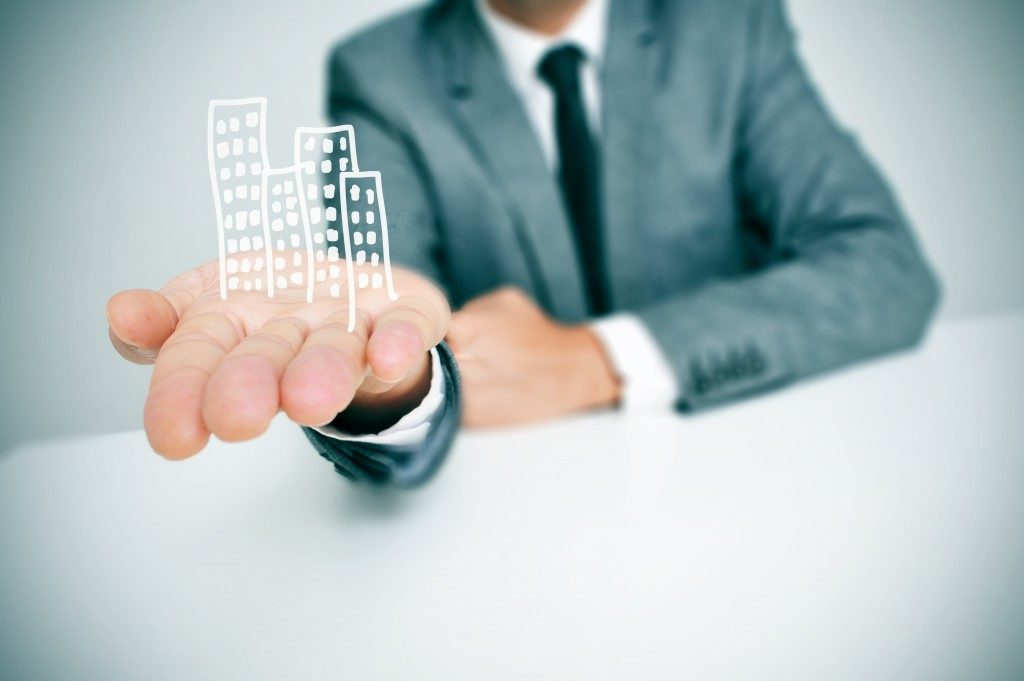 buildings on businessman's hand
