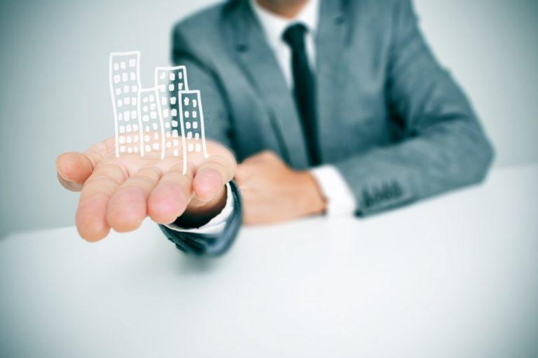 buildings on businessman's hand