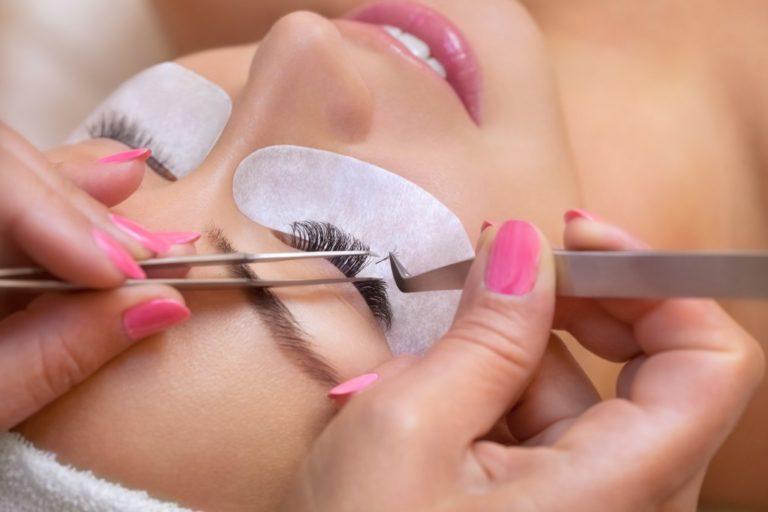 woman undergoing eyelash extension procedure