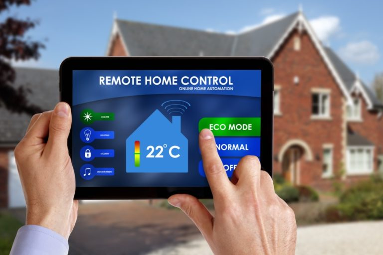 Person holding a remote home control