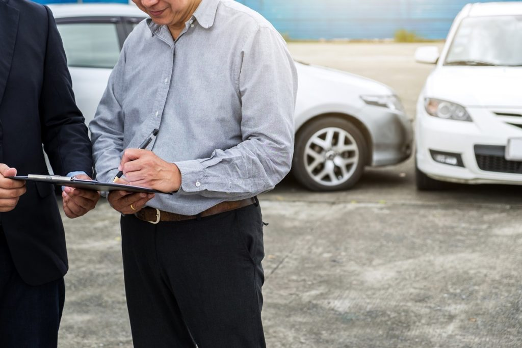 Signing documents for accident documentation