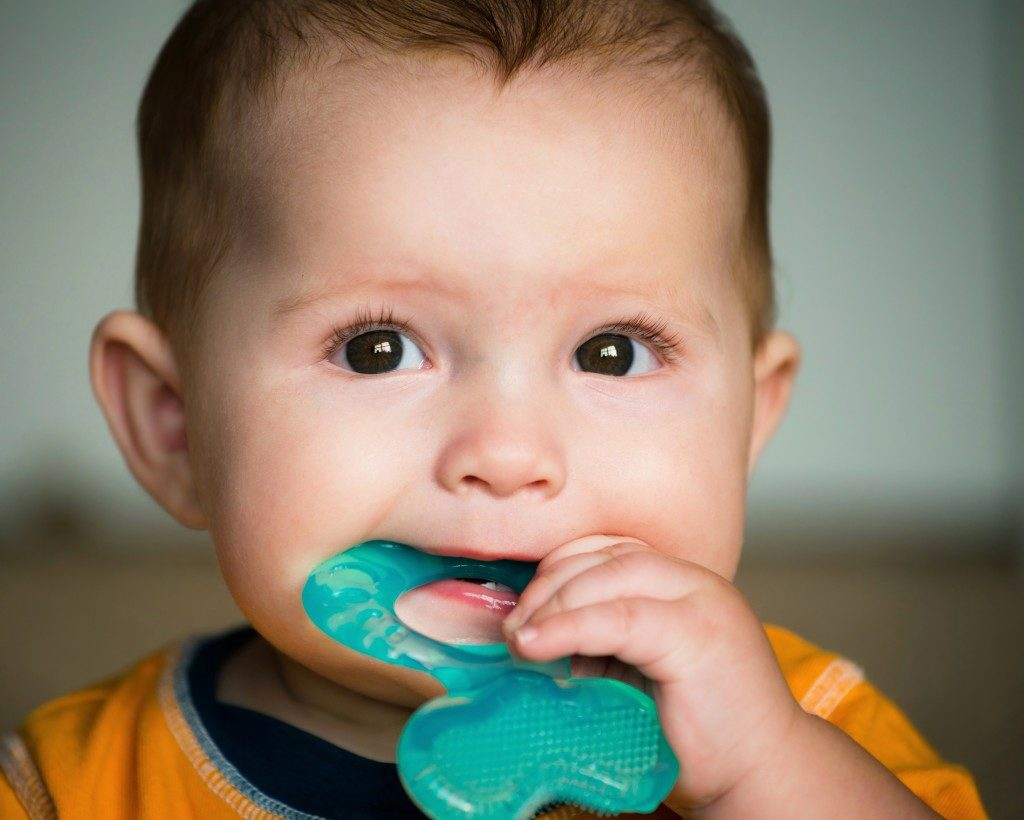 baby playing with teething toy