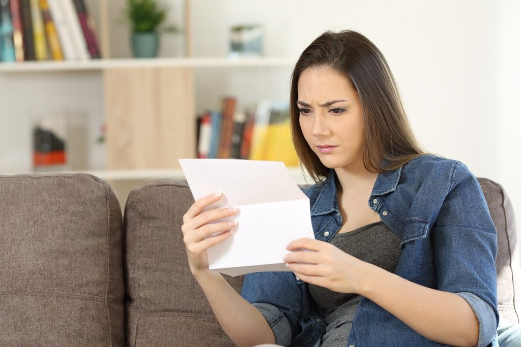 woman reading her denied business loan application