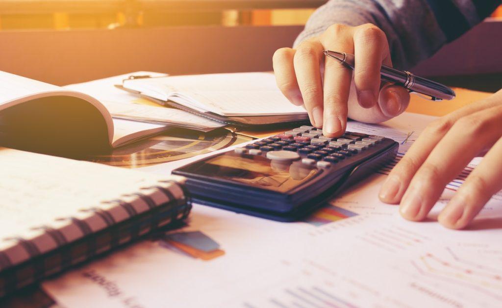 person computing his finances