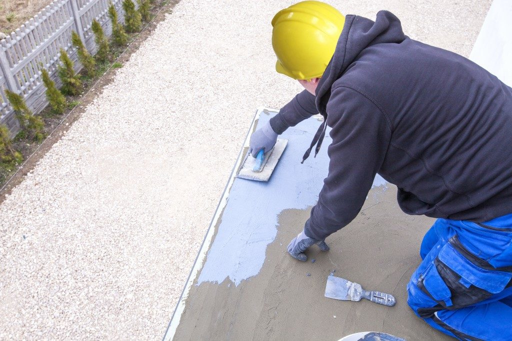Manual concrete laying