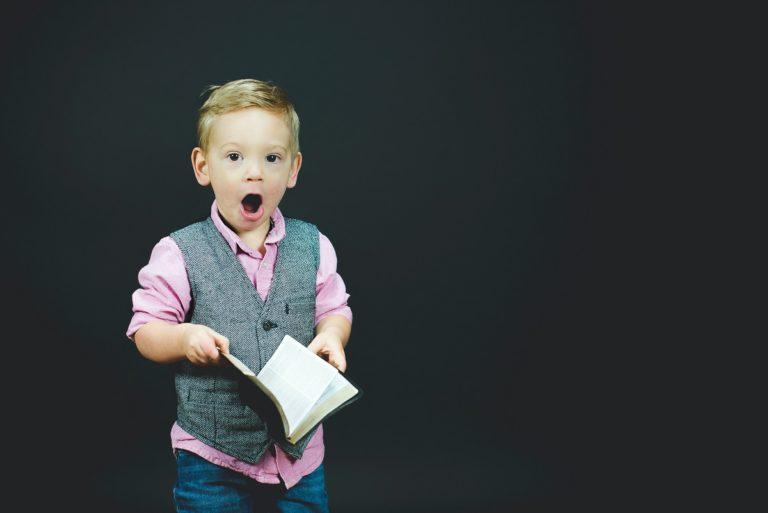 Boy holding a book