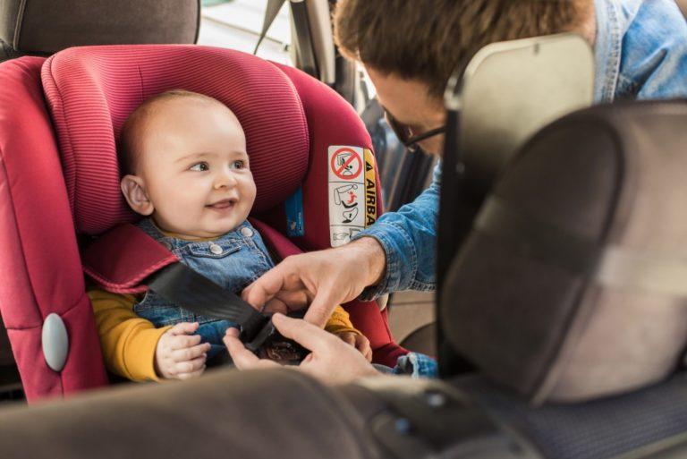 baby wearing car seatbelt