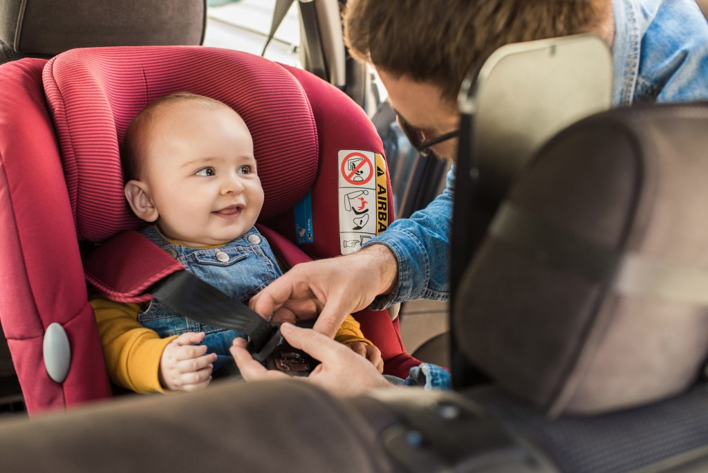 baby wearing car seatbelt