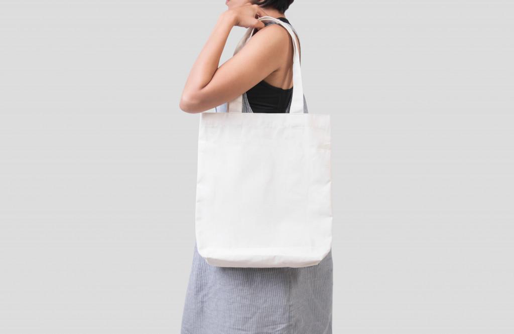 woman wearing tote bag