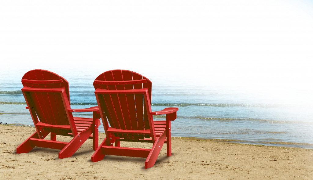 red beach chairs by the sea
