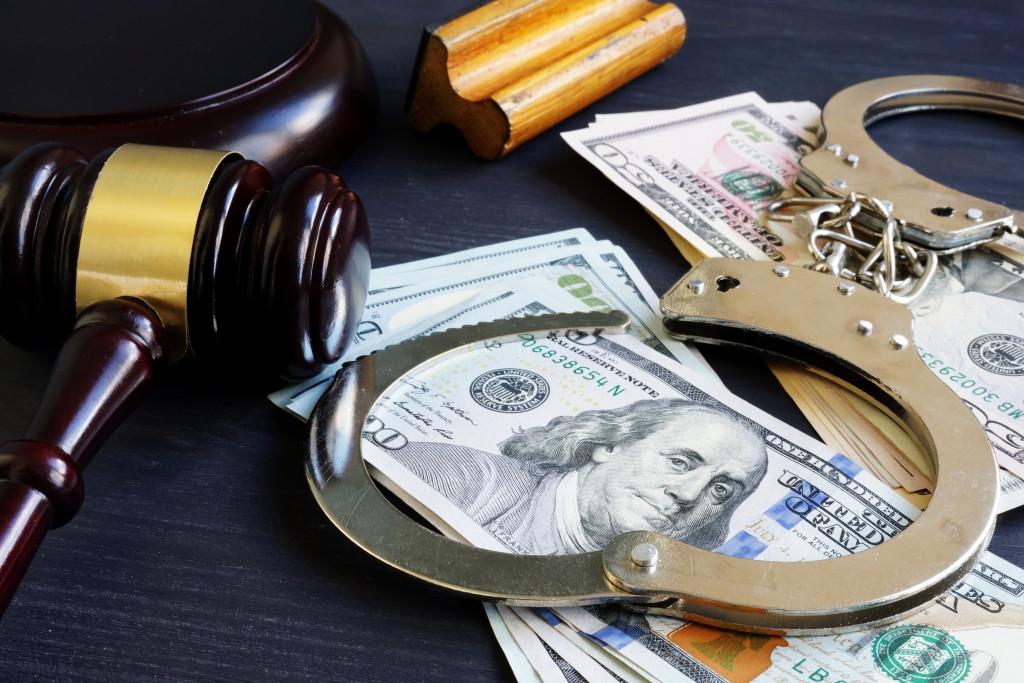 gavel, money, cuffs